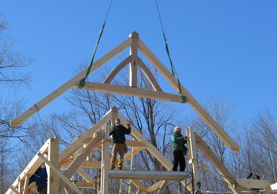 <b>Sainte-Marthe, Quebec</b><br>Timber truss being lowered by crane