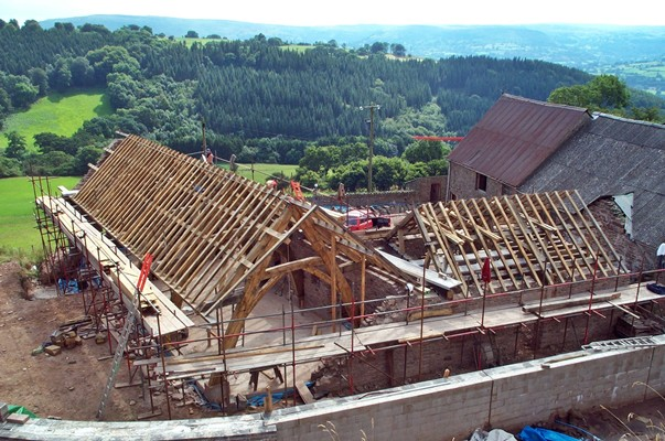 <b>Wales, UK</b><br>Traditional timber framed cruck barn, built while employed by Carpenter Oak & Woodland Co.