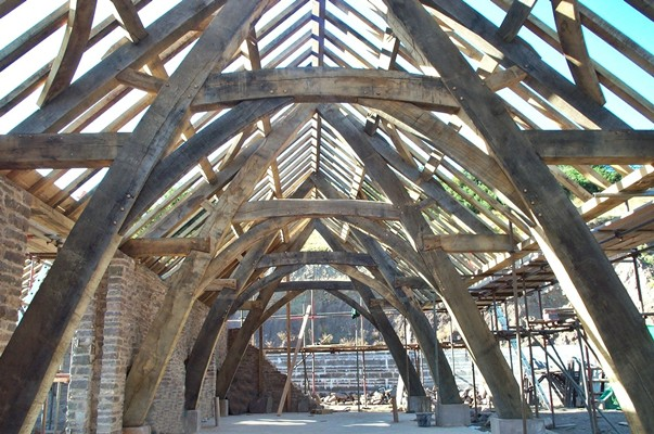 <b>Wales, UK</b><br>Traditional full cruck framed barn, built while employed by Carpenter Oak & Woodland Co.