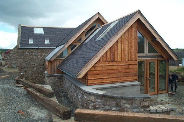 <b>Scotland, UK</b><br>Exterior of new oak timber frame, built while employed by Carpenter Oak & Woodland Co.